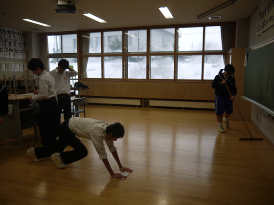 students clean a Japanese classroom