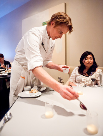 Chef Grant Achatz preparing dessert on a table at Alinea - photo by John Joh